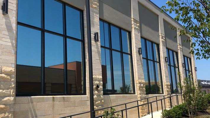 The Pros and Cons of Manufactured Glass vs. Window Film Annapolis, MD solar window film in Annapolis, MD