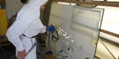 Artist Sand Blasting Etched Glass